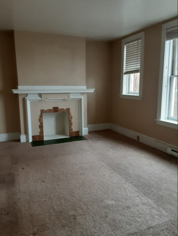 Living Room with Faux Fireplace